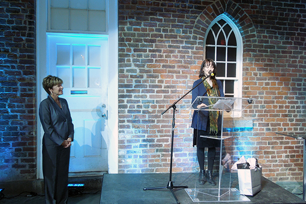 Councillor Mae Rowe accepting the Community Arts Award from Mary Jane Lamond